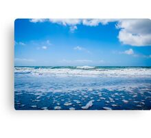 Ocean waves and blue sky with clouds Canvas Print