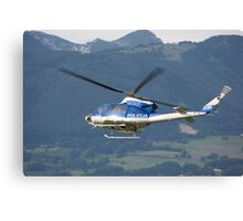 Police helicopter patrolling Canvas Print