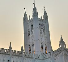 Clock Tower of St. Paul's Cathedral, Calcutta during dusk by srijanrc