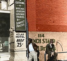 1939 Memphis, Two African American men in street in front of sign for pawn shop and Atlas Hotel. by Marie-Lou Chatel