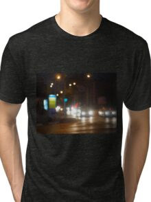 Defocused lights on the stream of cars and traffic lights Tri-blend T-Shirt