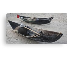 Resting canoes Canvas Print