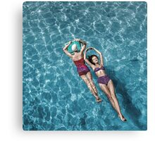 1948 Fashion models posing in bathing suits floating in a swimming pool Canvas Print