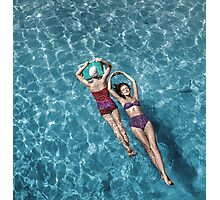1948 Fashion models posing in bathing suits floating in a swimming pool Photographic Print