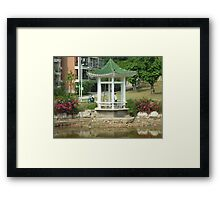 lazyfishing in shallow pond from tiny colourful pagoda Framed Print