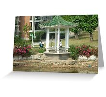 lazyfishing in shallow pond from tiny colourful pagoda Greeting Card