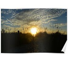 Sunrise with snowy blue clouds Poster
