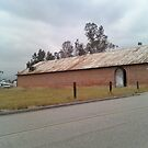 Brick Building Next To A Field by Bearie23