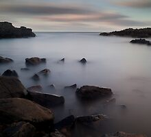 sunset over cove bay (1) by codaimages