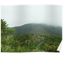powerful rainclouds enveloping stark towering powerful mountiantops Poster