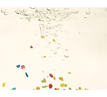 Multi coloured pebbels falling through water with bubbles Photographic Print