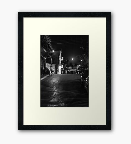 Moon over Town Framed Print