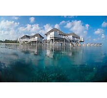 Half in, half out - Maldives reef houses Photographic Print