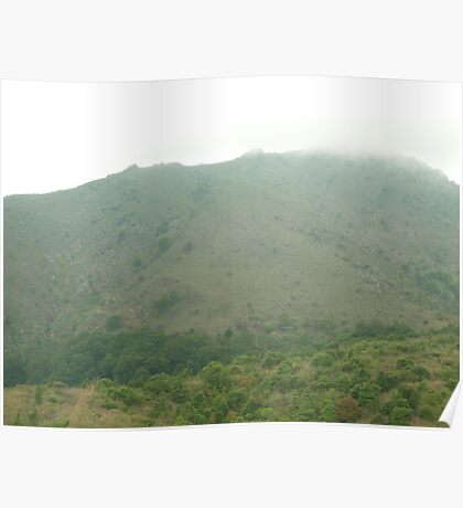threatening rainclouds caress stark mountain top Poster