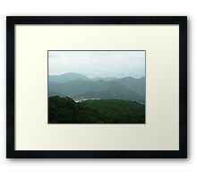 towering waves of jungle mountains wth threatening rainclouds drifting by Framed Print