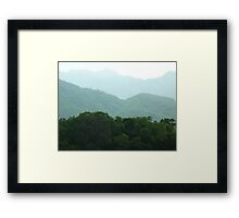 waves of lushgreen jungle mountains Framed Print