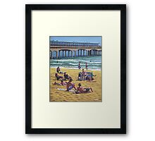 people on Bournemouth beach Boys looking Framed Print