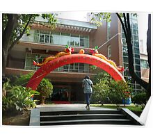 Chinese_woman_walking_up_steps_in_front_of_red_inflatable_dragon Poster