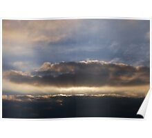 Sunset behind clouds with rays Poster