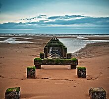 Stumps over pipework - Blackpool beach by AttiPhotography