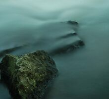Water flowing over rocks by Emma Schroeder
