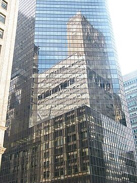 Reflection in New York Office Building by lenspiro