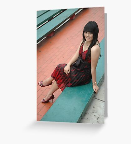 young lady wearing black and red gown Greeting Card
