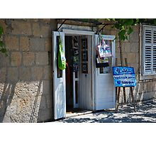 Shop on the city wall Photographic Print