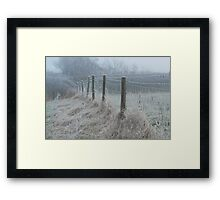 The ice covered rickety fence Framed Print