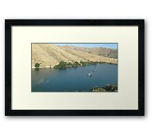 A Lake with Piers and Boats on it. Framed Print