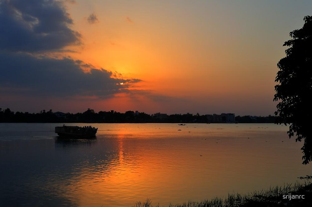 Sunset, boat heading towards horizon, golden rays, river ganges by srijanrc