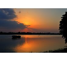 Sunset, boat heading towards horizon, golden rays, river ganges Photographic Print