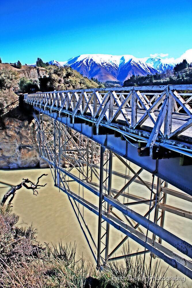 Bridge over muddy river by Faith Barker Photography