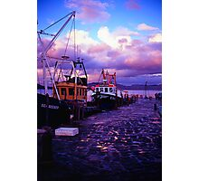 Fishing boats in the evening at lyme regis cobb Photographic Print