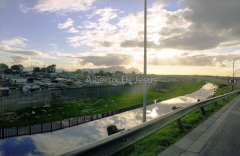 Sunset by Capetown Flats by Alberto  DeJesus