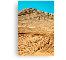 Layered Desert Rocks Under Blue Sky Canvas Print