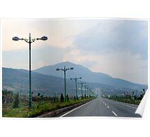 Highway to Da Lat (Dalat) cutting through countryside. Vietnam. Poster