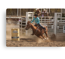 Rodeo Cowgirl Competes in Barrel Racing Event Canvas Print