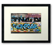 Abstract Graffiti on the grunge textured Brick Wall Framed Print