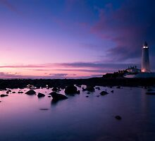 The lighthouse at dusk by Angi Wallace