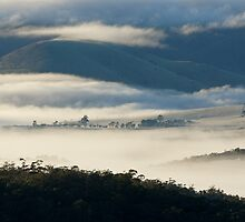 Fog lifting off the valley by Ron Co