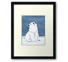 Polar bear cub in snow Framed Print
