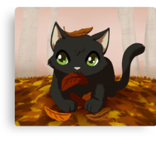 Kitty playing in autumn leaves Canvas Print