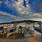 Boat parking by Hercules Milas