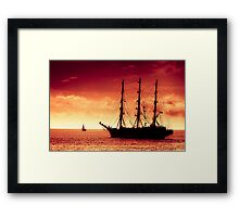 Sailing to red sunset Framed Print