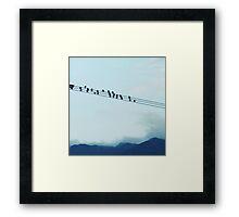 Birds on telephone line Framed Print