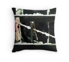Snow covered pegs on a washing-line Throw Pillow