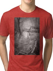 in this dark forest, lights can be seen Tri-blend T-Shirt