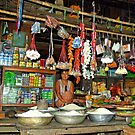 Typical  Burmese village shop. by John Mitchell