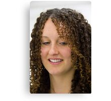 Beautiful girl with a corkscrew curl Canvas Print